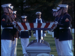 """Figure 7 - """"...the traditional, ceremonial draping of the veteran's coffin here is affirmative, placing the veteran firmly within a nation that recognises his sacrifice"""""""