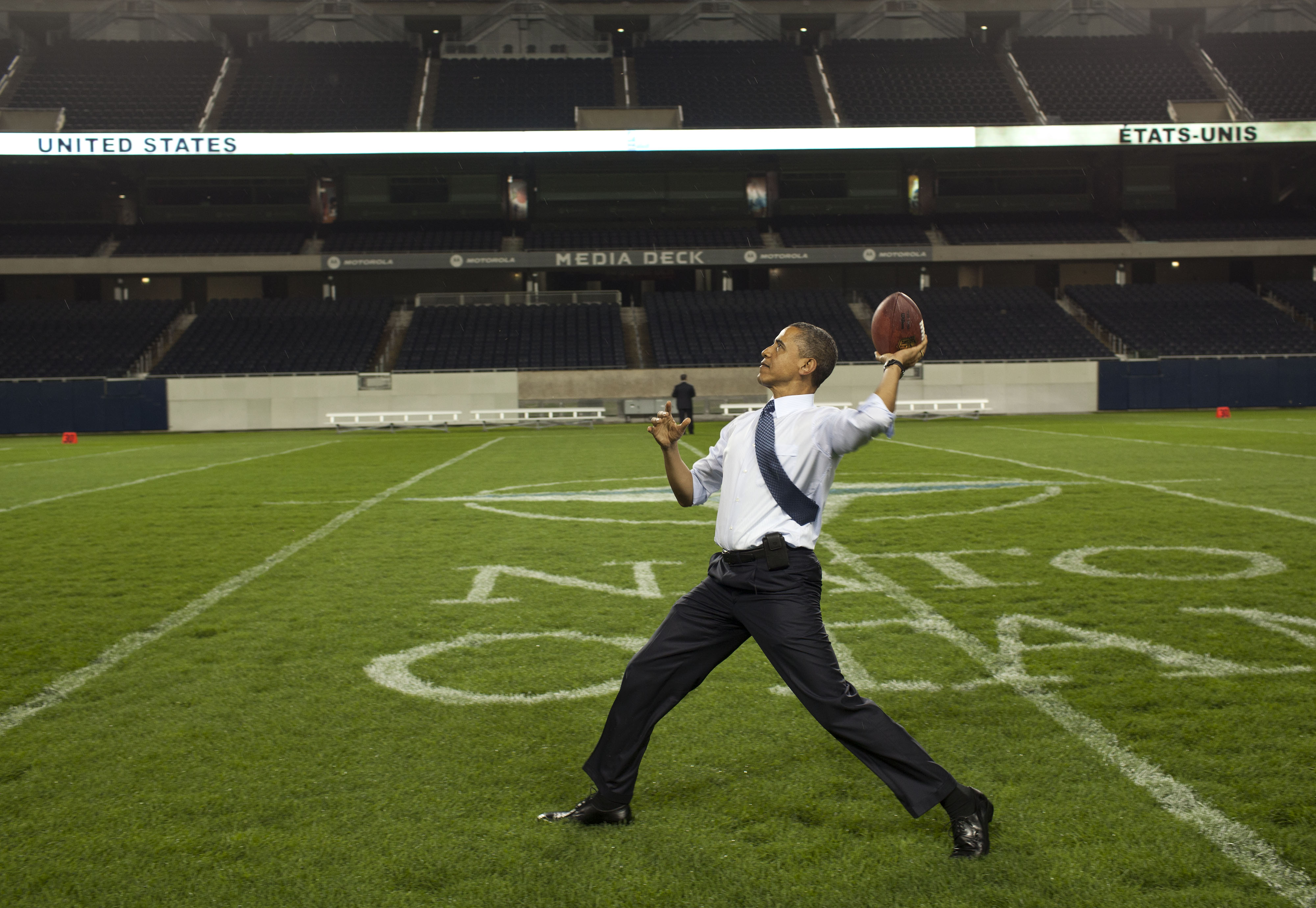 44th President of the United States, Barack Obama, throws a football at Soldier Field